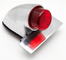 Picture of Replica polished alloy Sparto rear lamp with integral number plate mount and projected lens.